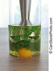 olive oil, egg yolk, dill in a glass with immersion blender to prepare a creamy sauce