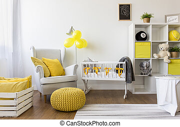 How to decorate a nursery - Shot of a modern cozy baby room...