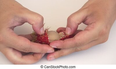 How to Peel a Rambutan Fruit. 1080p footage 1080p - Hands...