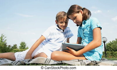 How to use touchpad - Cute girl explaining to his brother...