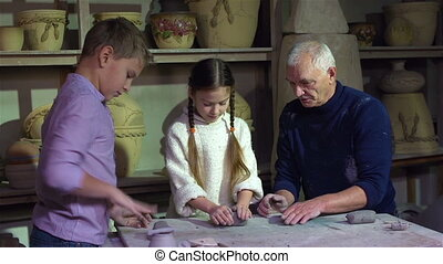 How To Wedge Clay - Senior craftsman teaching kids how to...