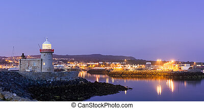 Howth village and Harbour Lighthouse at twilight