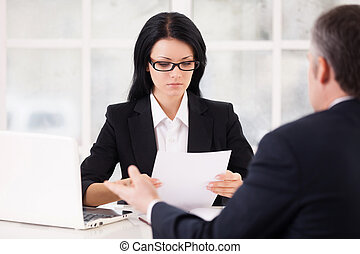 HR director and job candidate. Confident young woman in...