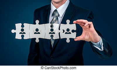 HR - Human Resources - business concept with hand businessman and puzzle