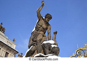 Battling Titan at the gate of Castle in Hradcany. Prague, Czech Republic