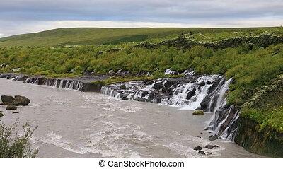 Hraunfossar waterfall in Iceland - Hraunfossar waterfall...