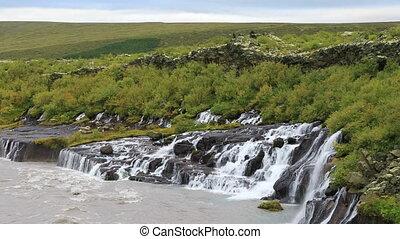 Hraunfossar waterfall in west Iceland - Hraunfossar...