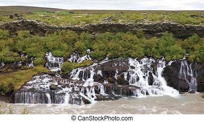 Hraunfossar waterfall near Husafell in Iceland - Panoramic...