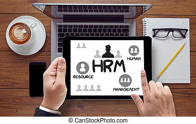 HRM Human Resource Management Strategy Planning Working HRM man, on the tablet pc screen held by businessman hands - online, top view
