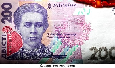 Hryvnia bill Ukrainian money burning in flames, economic...