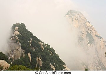 Huashan Mountain in China - Pavilion in clouds at Huashan...