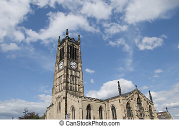 A Church and Clocktower in a Yorkshire Town under a blue sky