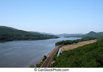 A summer view of the Hudson River looking north at the Historic Hudson Valley, taken from the Bear Mountain Bridge.