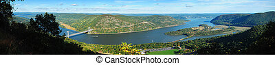 Hudson River valley panorama in Autumn with colorful mountain and Bear Mountain Bridge over Hudson River.