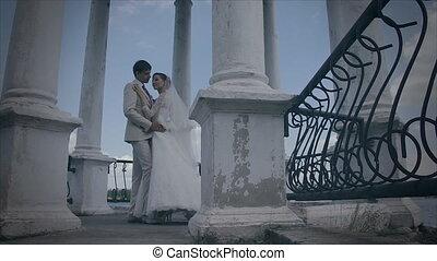 Hug lovers stand on the bridge