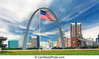 Huge American flack and St. Louis skyline with capital and famous arch