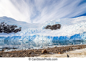 Huge Antarctic glacier reflected in the Antarctic waters of Neco bay, Antarctica