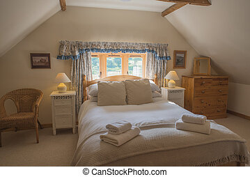 Huge Bed and Other Furnishings in Vacation Cottage Attic Bedroom