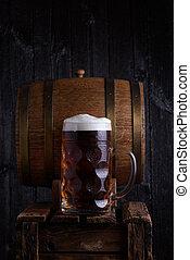 Huge beer mug on old wooden crate