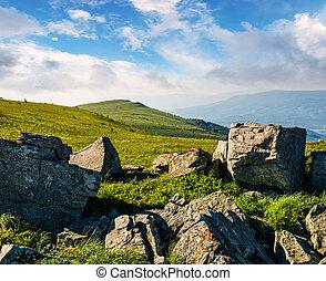 huge boulders on a grassy hillside at sunrise. gorgeous...
