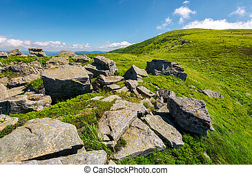 huge boulders on the edge of hillside. fine weather in...