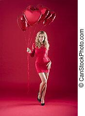 Huge bunch of red heartshape balloons