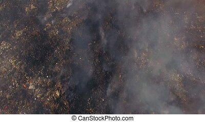 Huge Burning Waste Deposit Covered With Smoke - AERIAL VIEW....
