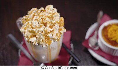 Huge caramel cocktail with popcorn topping and a dessert. -...