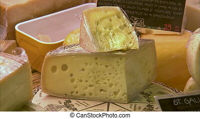 Huge cheese block in the market - A block of cheese being...