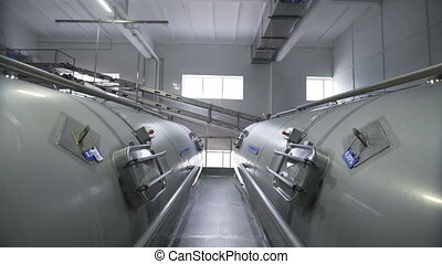 Huge cisterns for storing and fermenting milk. Equipment at...