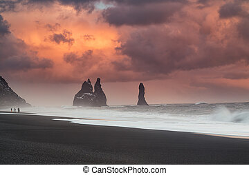 Huge clouds over black sand beach in Iceland