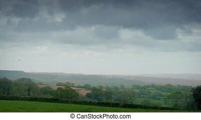 Huge Clouds Over Rural Landscape - Timelapse view of...