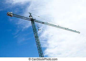 Huge construction crane with cloudy sky background