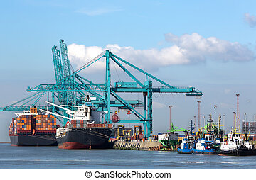 Huge container ships being loaded with cranes in Antwerp...