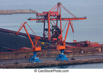Huge cranes at a port charge