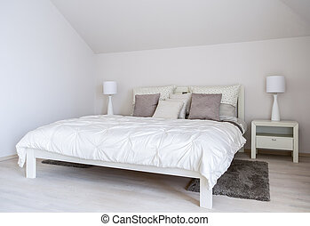 Huge double bed in bedroom