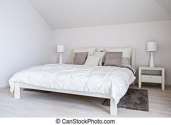 Huge double bed in bedroom