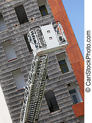 huge elevator cage of fire truck with ladder