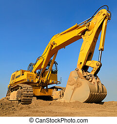 Huge excavator in front of cloudless sky - Heavy earth mover...