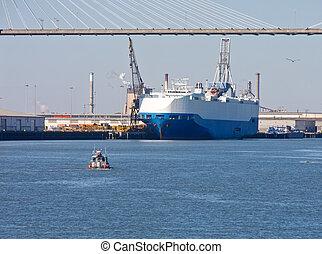 Huge Ferry at Dock Under Bridge