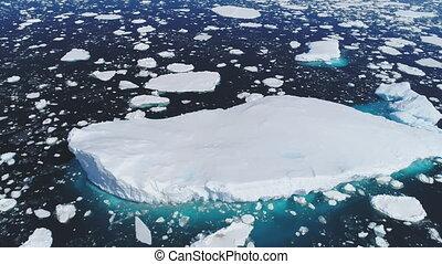 Huge floating iceberg aerial tracking shot - Huge Floating...