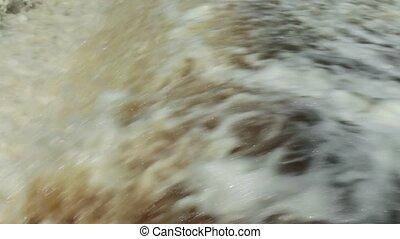 huge flow of water blustering waterfall