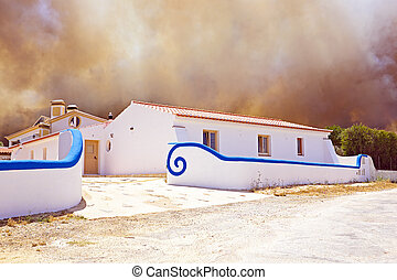 Huge forest fire threatens home in Portugal