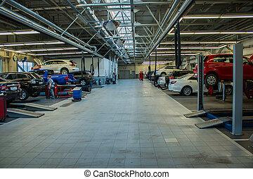 Huge garage for car repair with equipment