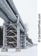 Huge gas pipeline laid along snowy street in Riga, Latvia