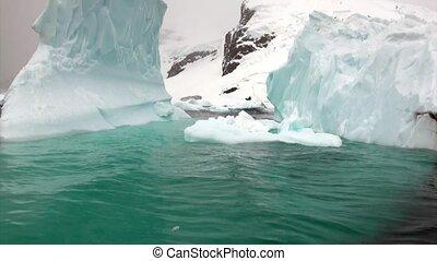 Huge giant iceberg and ice floe in ocean of Antarctica....