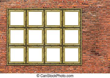 Huge golden frame over old brick wall