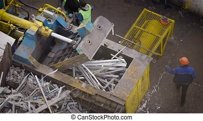 huge hydraulic scrap baling press machine is working,...