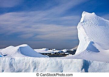 Huge iceberg - Huge icebergs in Antarctica, blue sky, sunny...