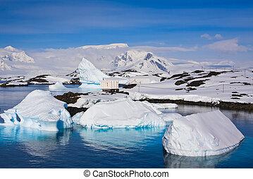 Huge icebergs in Antarctica, blue sky, azure water, sunny day